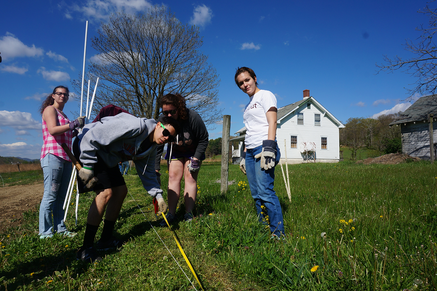 A group of students helps to build a fence in Catawba