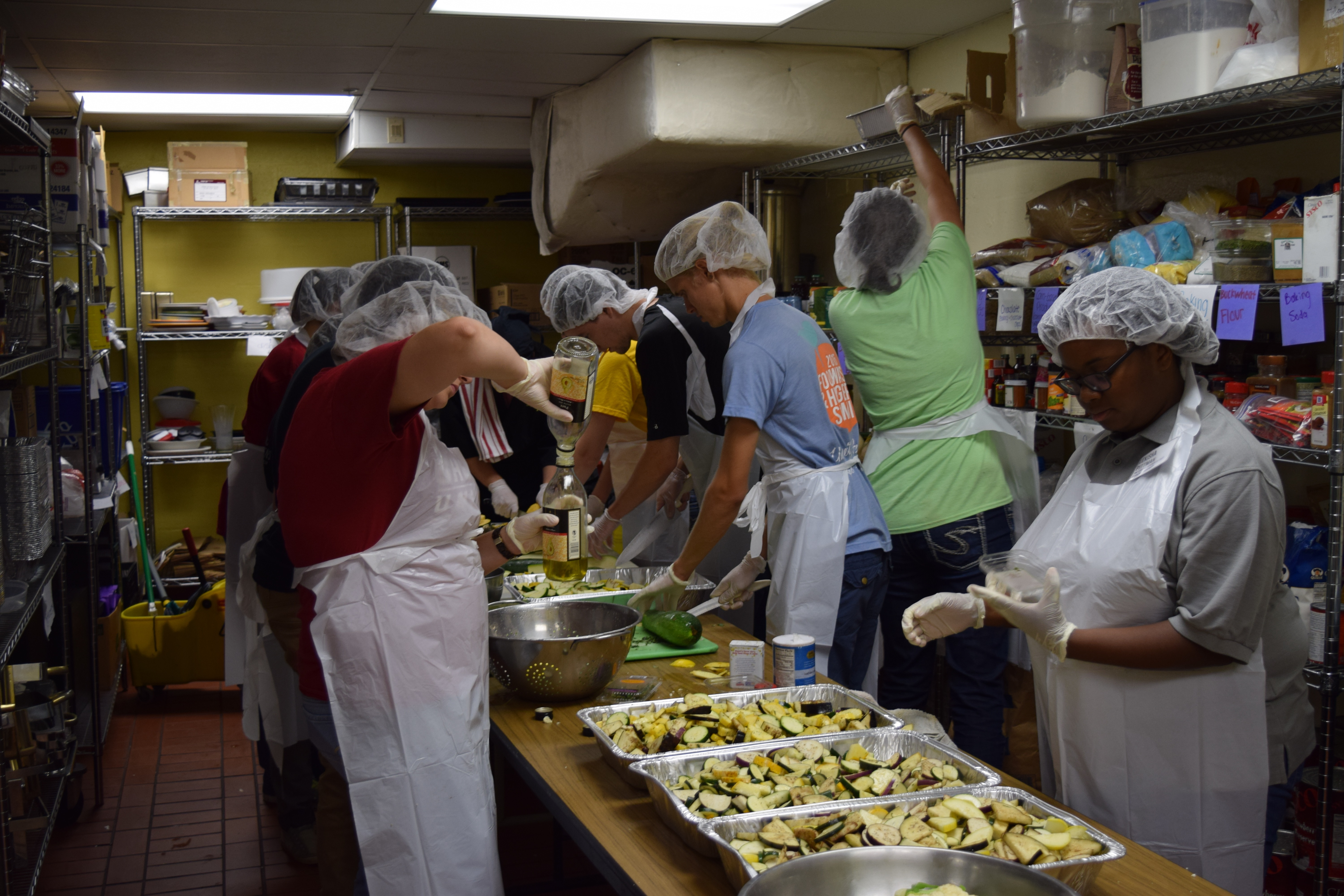 Students work in a Campus Kitchen to make meals for those in need