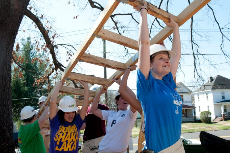 A group of students help to build a home through Habitat for Humanity