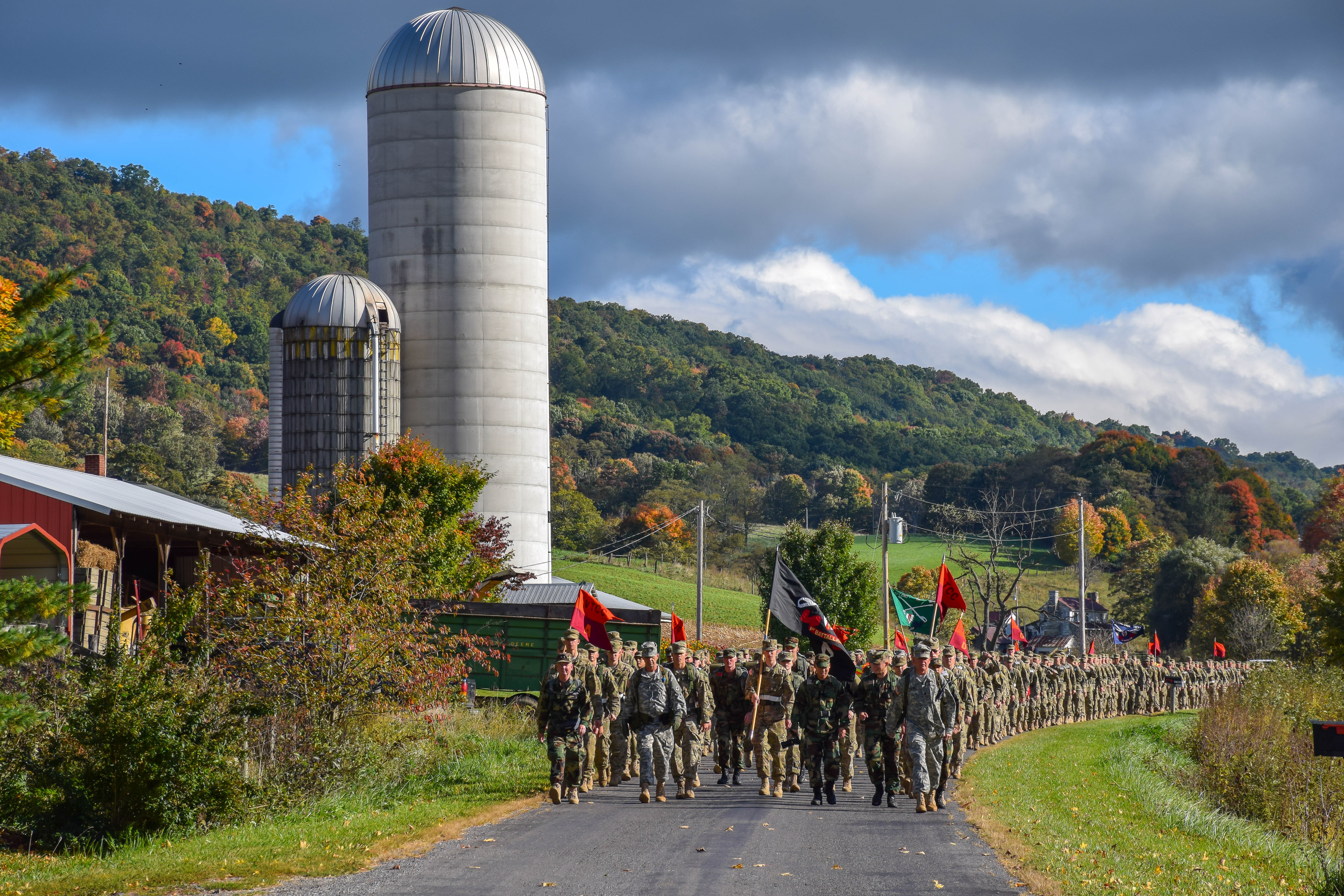 The Virginia Tech Corps of Cadets Class of 2018 march down a local road on the Fall Caldwell March in Oct. 2014.