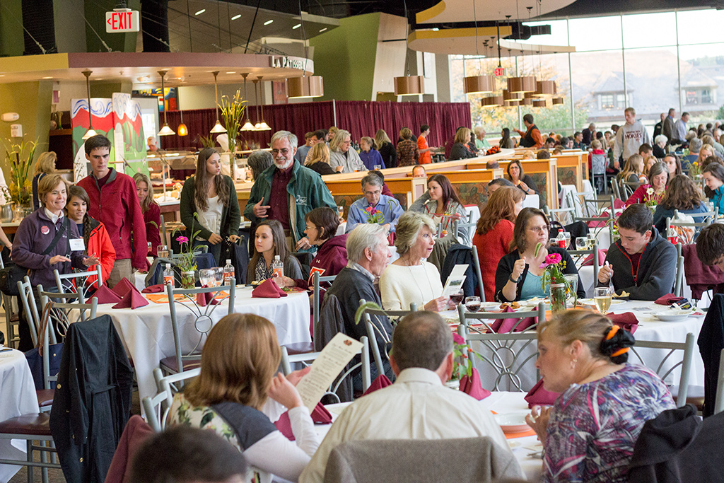 Families gather at tables to eat food in D2 during Fall Family Weekend