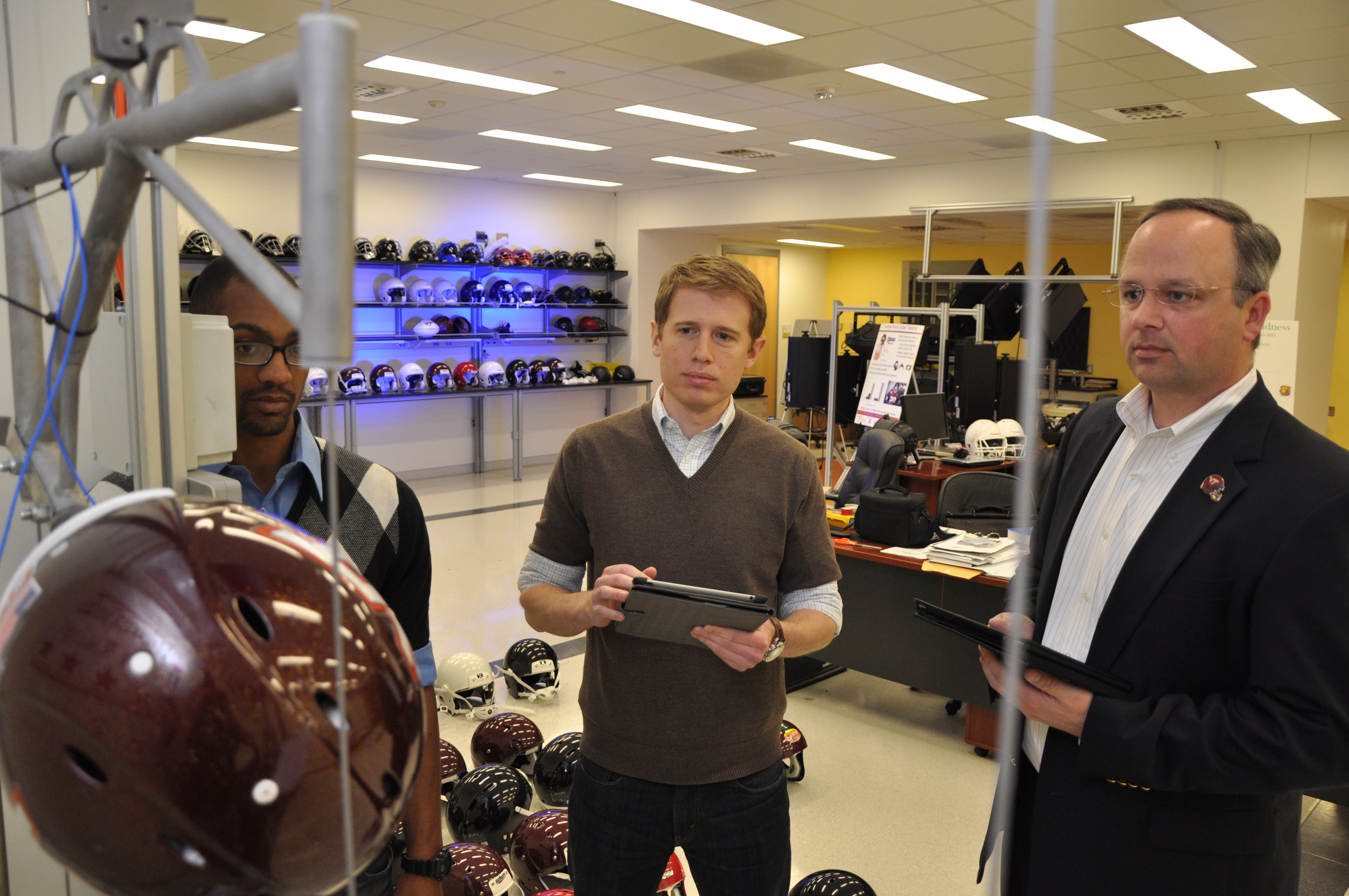 Steve Rowson and Stefan Duma inside the Virginia Tech helmet lab
