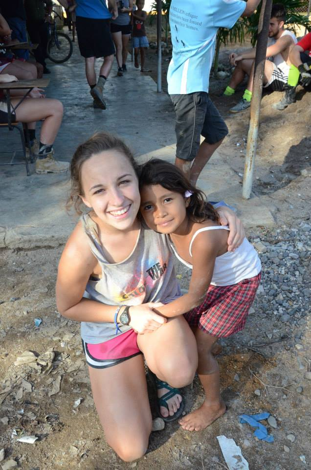 Anastasia poses with a child in Honduras