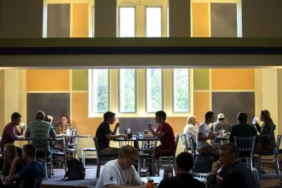 students eat and relaxing at Hokie Grill