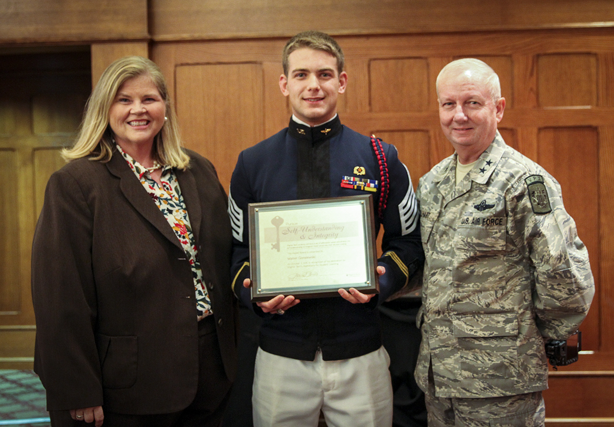 Cadet Walter Gonsiewski poses with Major General Randal Fullhart and Vice President for Student Affairs Patricia A. Perillo at the October Aspire! Awards Breakfast.