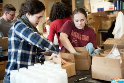 Students work to assemble water test kits that will be sent to Flint, Michigan, residents.
