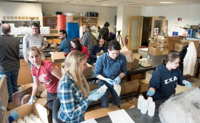 Students assemble water test kits in Durham Hall.