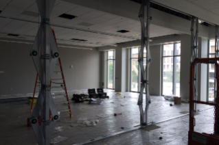 "Crews are installing a ""skyfold"" in a classroom, which is a sound control partition allowing classrooms to be divided when needed."