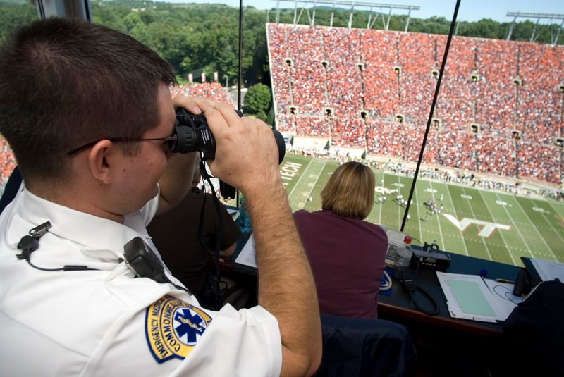 A rescue squad members monitors a home football game