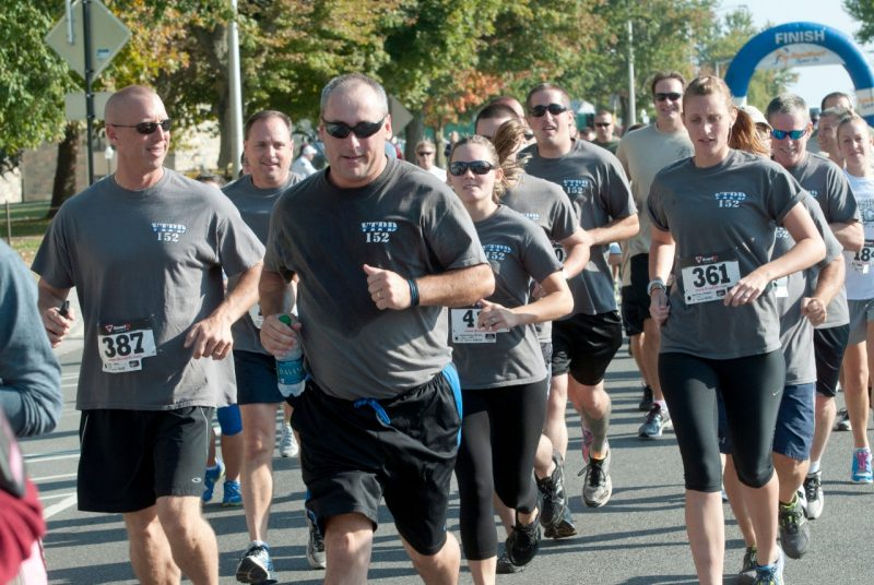 Members of the Virginia Tech Police department complete a run.