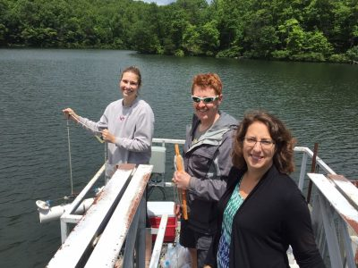 Madeline Schreiber, a professor of geosciences in the College of Science (far right) visits Falling Creek reservoir with undergraduate Katie Krueger of Asheville, NC and former graduate student Zack Munger.