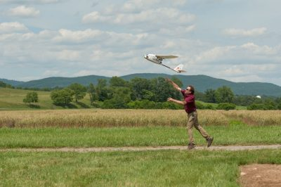As part of the traffic-management test, John Coggin, chief engineer for the Virginia Tech Mid-Atlantic Aviation Partnership, launches a fixed-wing unmanned aircraft which flew beyond its operator's visual line of sight on a simulated mapping mission. Coordinating the flights of different types of aircraft performing different tasks will be necessary for managing real-world unmanned aircraft traffic.