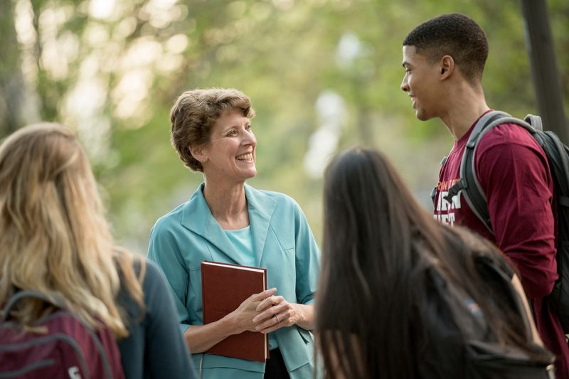 Sally Morton speaks with students