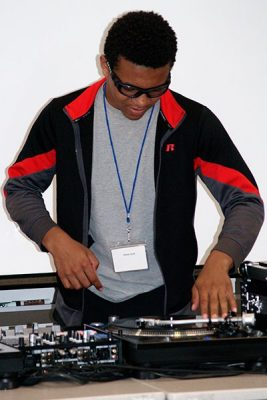 Student using DJ turntables