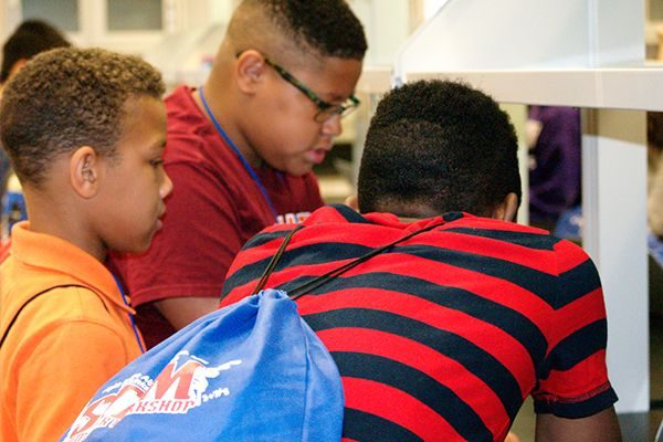 Students work together on an experiment at the STEM Summer Workshop. Photo by Vonita Brim Edwards.