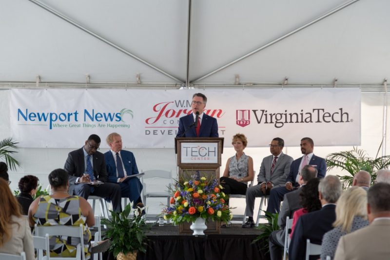 President Tim Sands speaks in front of a crowd at the groundbreaking ceremony of Building One @ Tech Center.