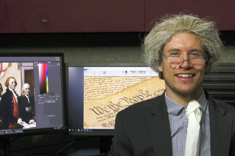 Maxwell Vandervliet in costume with partial screenshot of Founding Fathers