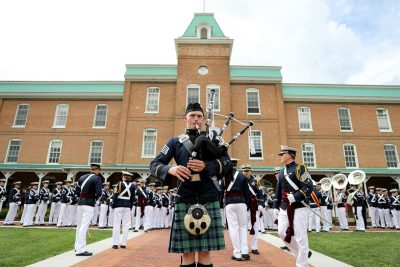 Cadet Camillus Huggins and the Highty-Tighties play in front of Lane Hall.