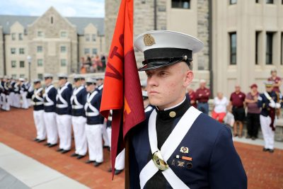Cadet Colin McNees carries the guidon for the corps' Alpha Company.