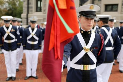 Cadet Nicholas Carroll carries the guidon for the corps' Echo Company.