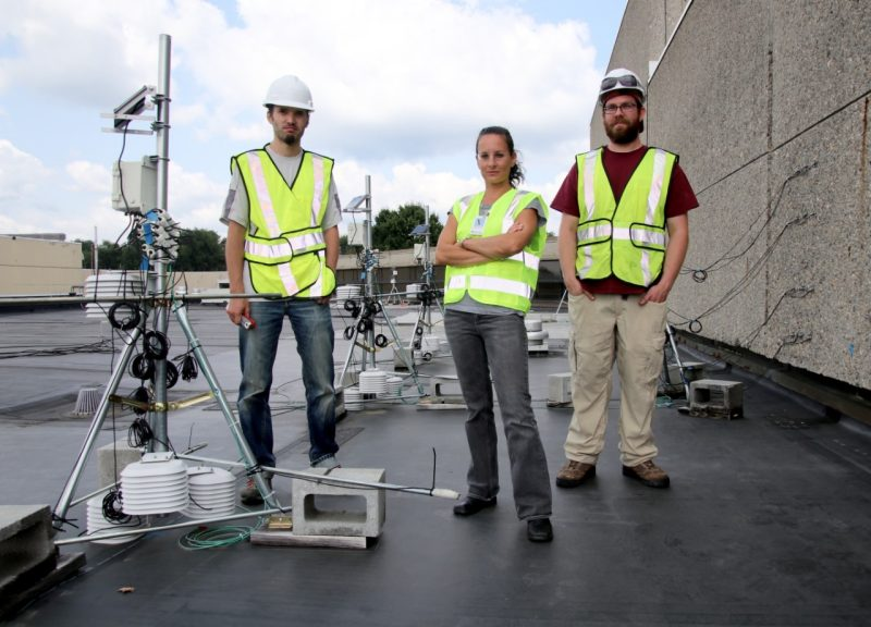 Elizabeth Grant and student researchers on roof.