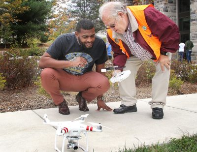 Marquis Harper, student at North Carolina Agricultural and Technical State, left gets some instruction form Dan Swafford, project associate at the Virginia 4-H, October 16,  during a drone demonstration at the Human and Agricultural Biosciences Building.