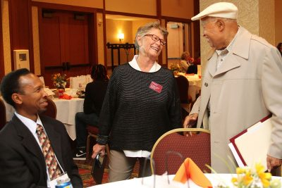 Sylvester Johnson, Karen Depauw, and Randy Grayson share a laugh during the networking lunch.