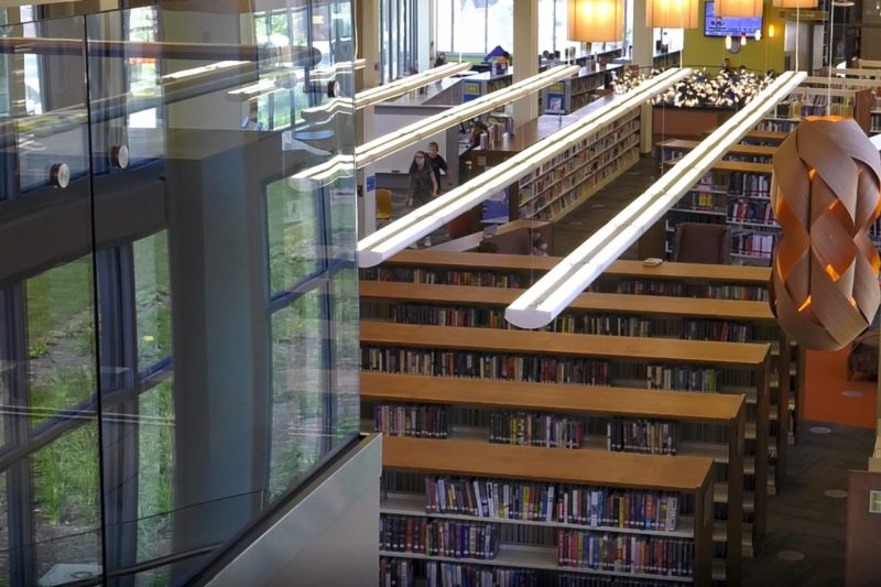 Vinton library interior from second floor looking down to stacks