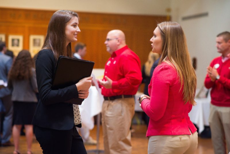 Carolyn Dixon (left), a junior studying marketing and management, chats with a Target representative during a networking session at the Student Leadership Conference in January.