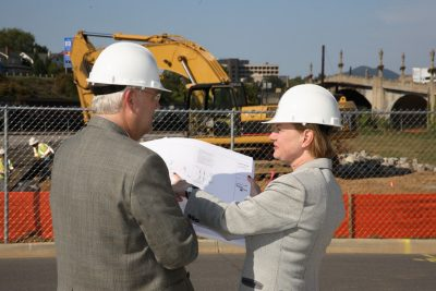 Founding Dean Cynda Johnson talks over construction plans with Dan Harrington, currently the school's vice dean.