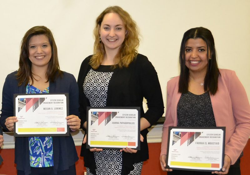 A photograph of Megan A. Lorincz, Joanna Papadopoulos, and Fadoua El Moustaid, three graduate students holding certificates recognizing their work as Citizen Scholars by the Graduate School