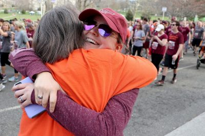 Two women hug during the 2018 Run in Remembrance
