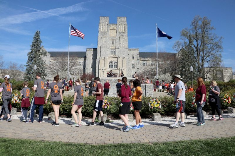 Participants in run visit April 16 Memorial