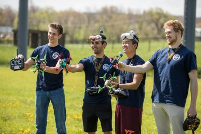 The Virginia Tech drone racing team shows off their aircraft, which zipped around inside the net near the conclusion of the ceremony. The drone park gives the top-ranked team a place to practice without having to rent indoor gym space.