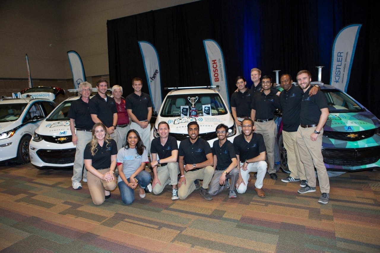 Victor Tango AutoDrive Team with their vehicle. Photo courtesy of SAE International.