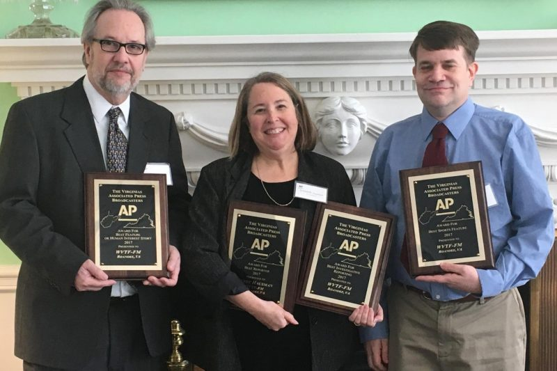 Luke Church, Sandy Hausman, and Jeff Bossert pose with their individual, first-place awards from the Virginias Associated Press Broadcasters