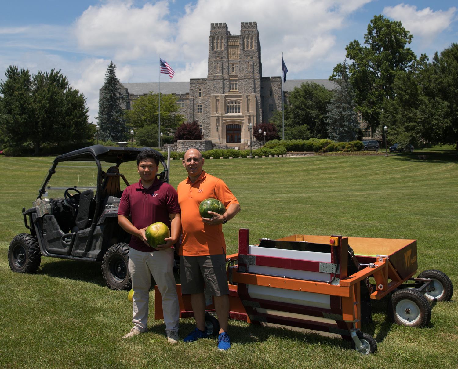 "Hongxu ""Howard"" Guo (left), a double major in mechanical and electrical engineering, and Alex Leonessa, mechanical engineering professor and advisor of the Virginia Tech agBOT team, with the autonomous watermelon harvester."