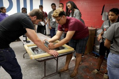 High school seniors experiment with screen printing during the Black College Institute at Virginia Tech.