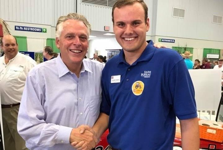 Virginia Tech Senior Chandler Vaughan shakes former governor of Virginia Terry McAuliffe's hand.