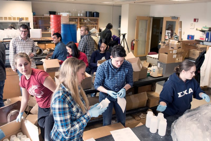 Flint water study research team in large room packaging test kits