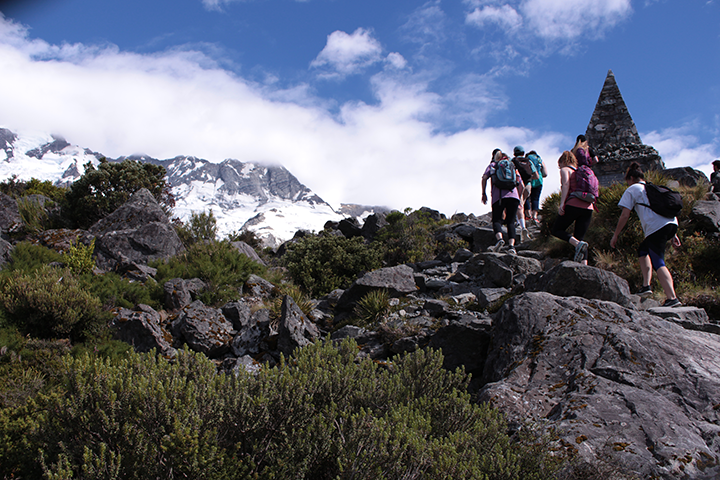 Students climbing a mountain during study abroad program.