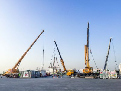Teams attending the Solar Decathlon Middle East can use cranes to assemble their houses at the competition site. (Photo by Laurie Booth)