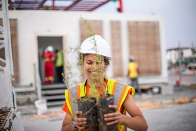Alexandra Schiavoni, a landscape architecture master's student from Boiling Springs, Pennsylvania, moves plants from a truck to the construction site.