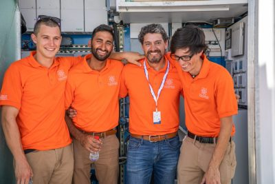 Left to right: Philip Kistler, Kunal Gandhi, Carlos Tarabillo (recently-graduated electrical engineering student from Santa Cruz, Bolivia), and Matt Erwin (recently-graduated electrical engineering student from Chesapeake, Virginia) in front of the house's mechanical room.