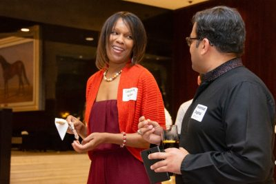 Latanya Walker, director of alumni relations for diversity, inclusion, and community engagement, talks with Muhammed Ahmad Chughtai, who graduated in 2004 with a bachelor's degree in electrical engineering.