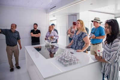 Joe Wheeler (left) leads a tour of FutureHAUS for VIrginia Tech alumni at the site of the Solar Decathlon Middle East.