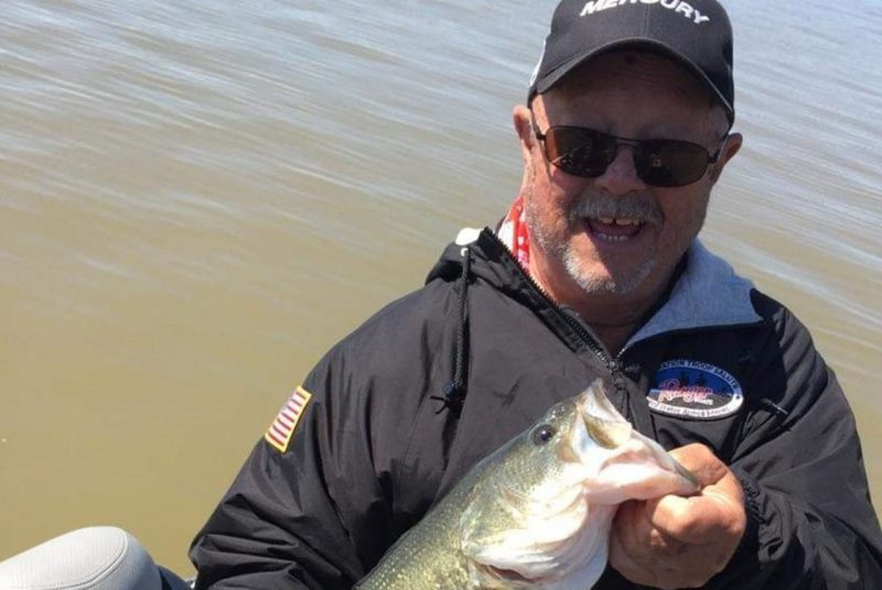Ed Clayton is shown holding a large fish.