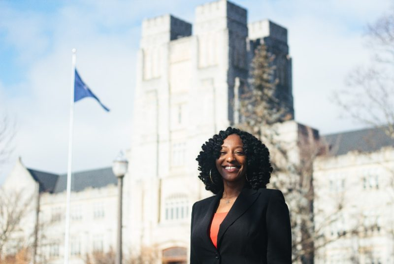 Janice Hall stands in front of Burruss Hall