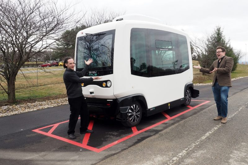 Saul Halfon (left) and Lee Vinsel playfully consider a low-speed autonomous shuttle undergoing testing at the Virginia Tech Transportation Institute.