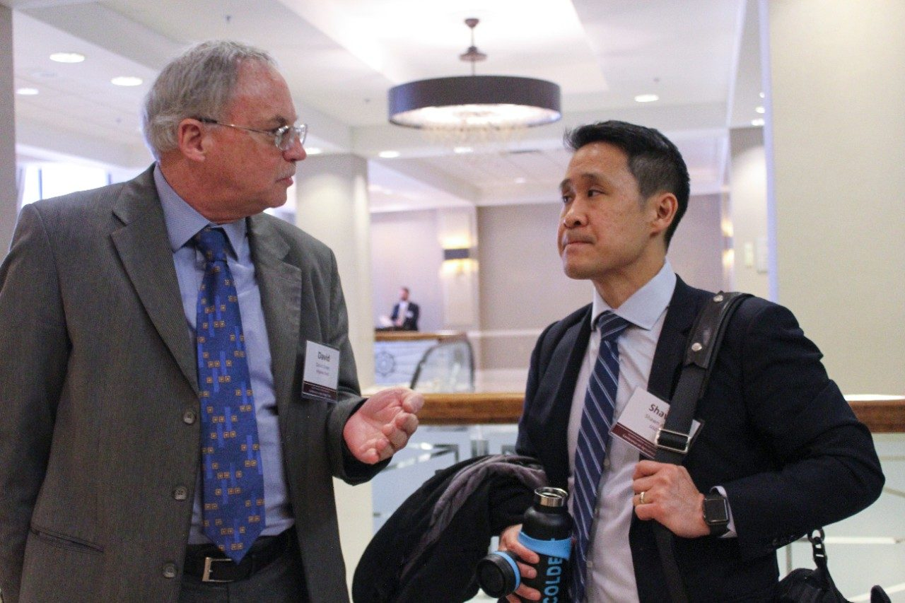 Professor David Orden speaks to Shawn Arita of the United States Department of Agriculture.